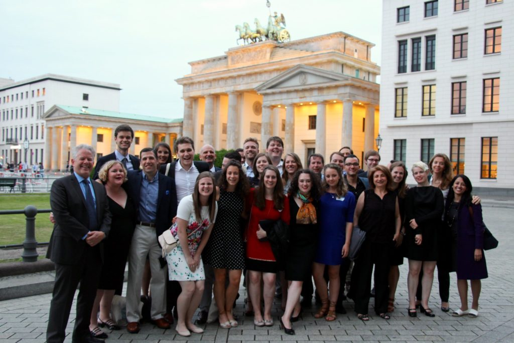 Group of MAGES alumni in front of the Brandenburger Gate