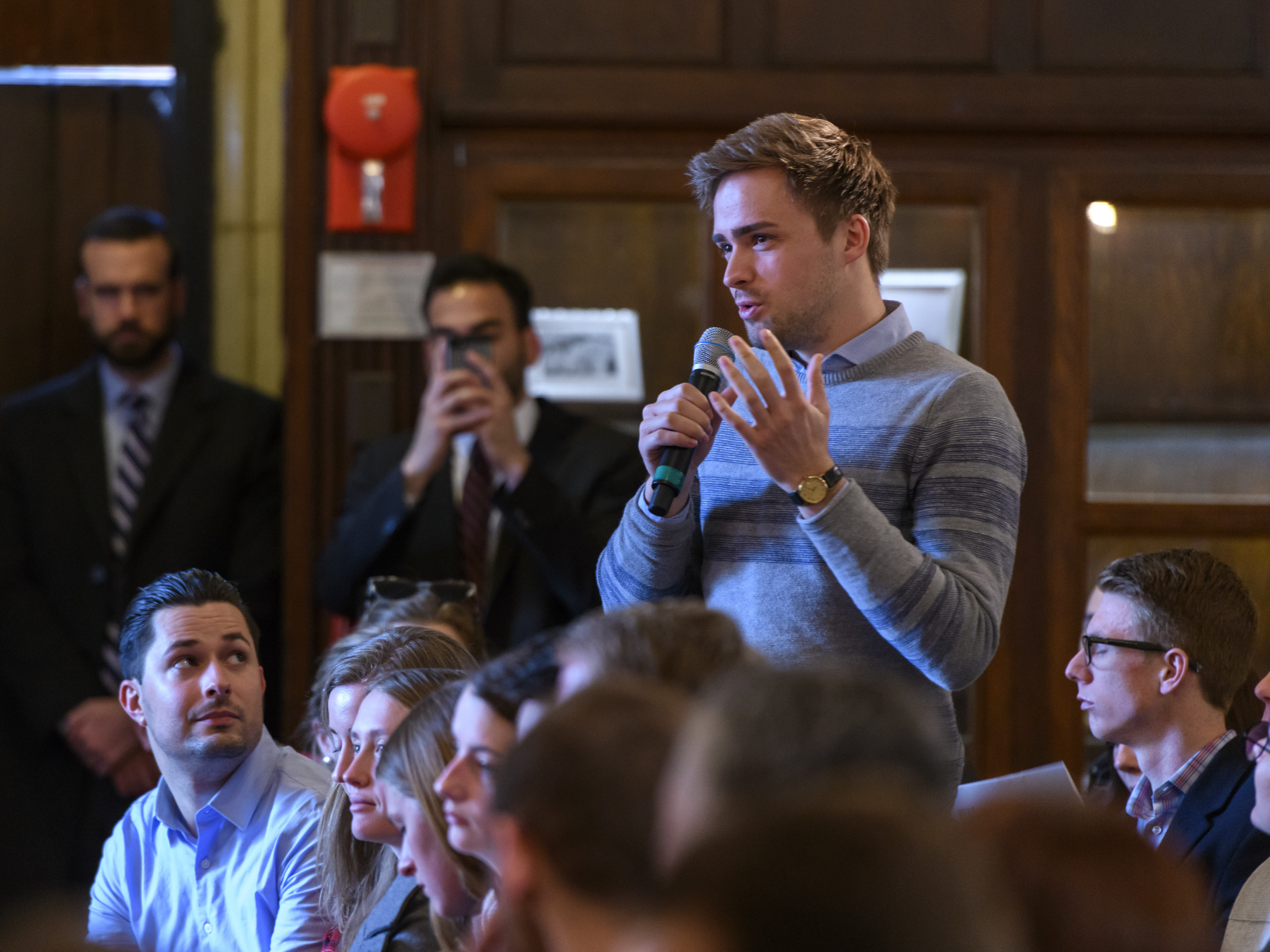 Photo of student asking a question at event