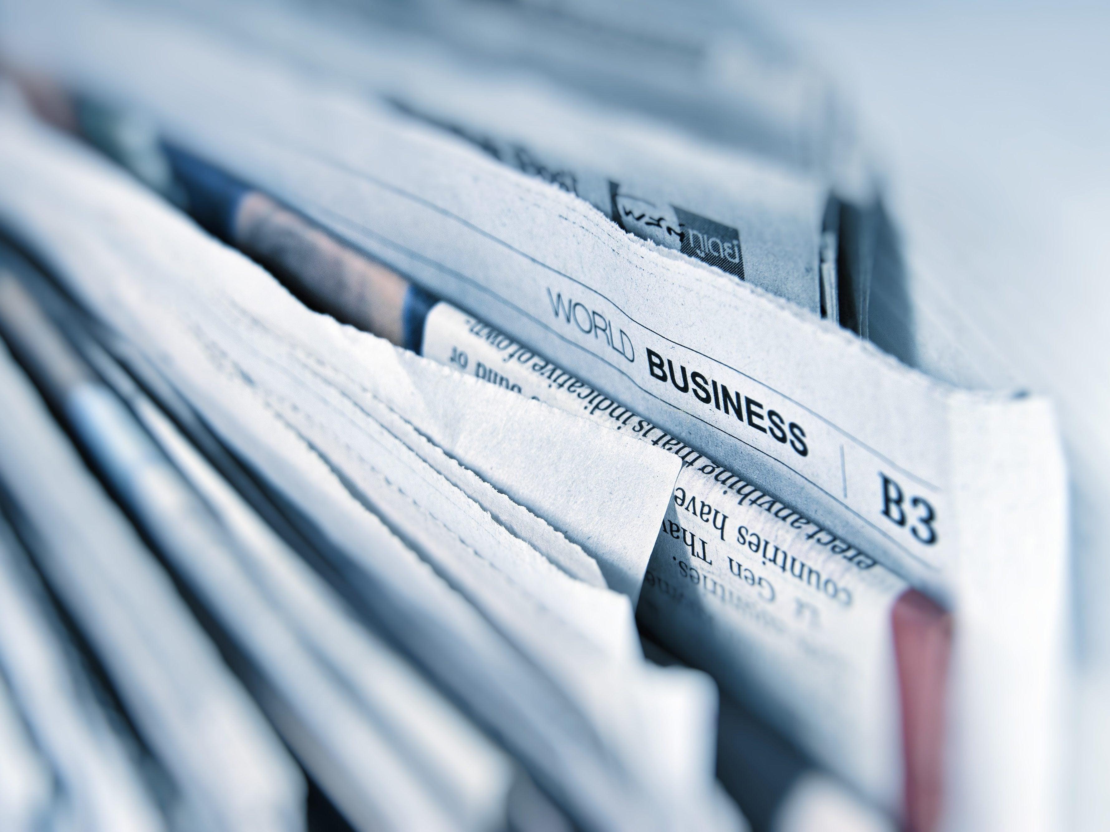 Shelf of newspapers
